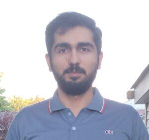 headshot of Shuja Khalid